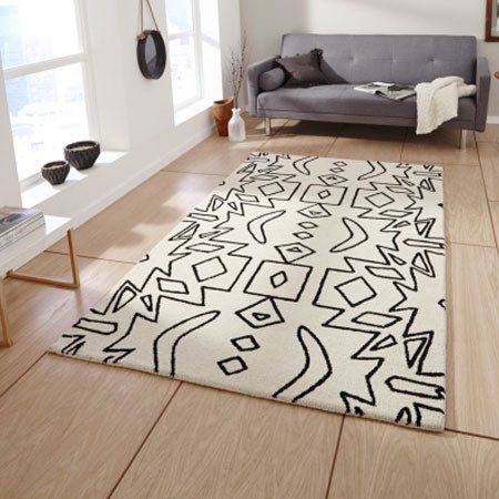 Funky white and black rug with jagged shaped design
