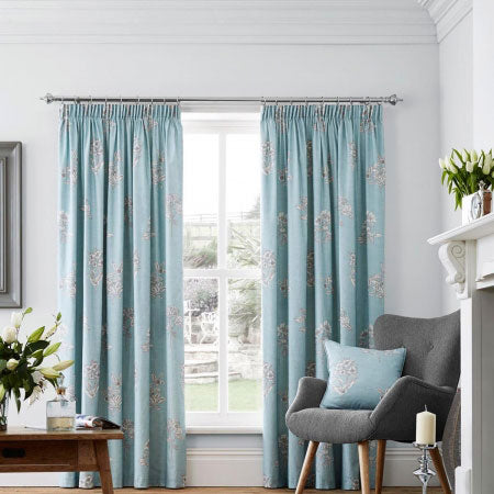 Duck egg blue and grey pencil pleat curtains at a living room window