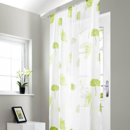 White and green floral voiles covering a back door