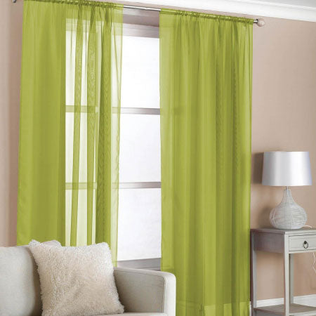 Bright green voiles at a living room window