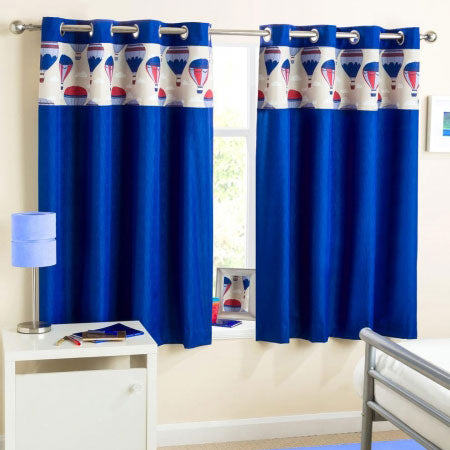 Dark blue short eyelet curtains in a cream bedroom, with hot air balloons at the top