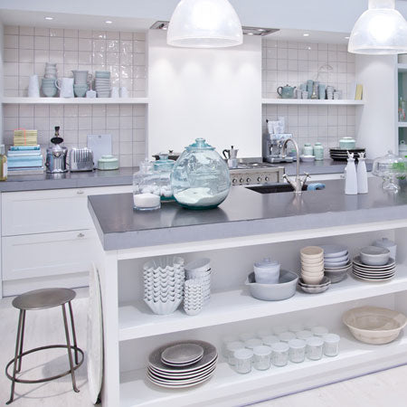 A very white and silver kitchen, looks very sterile and clean