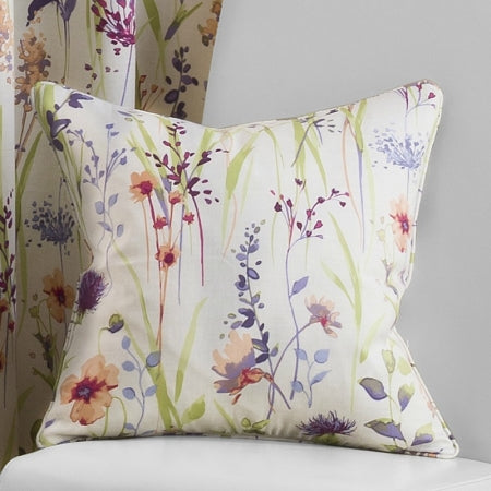 Cream cushion with green, purple and red floral design