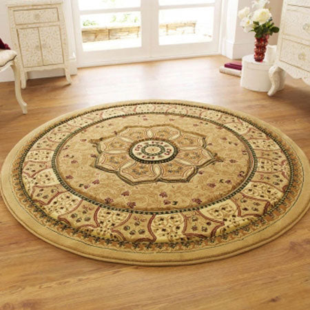 Round rug in gold with concentric circle pattern and floral shape in the centre