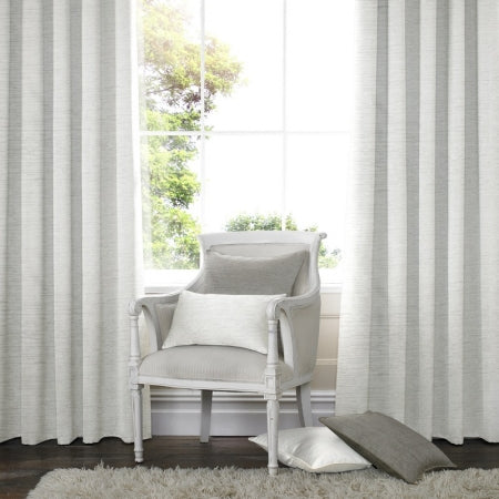 Light grey or dark white curtains at a window, with a wooden chair in the middle