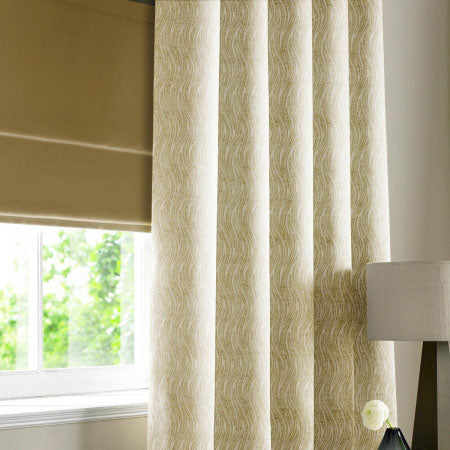 Creamy beige curtains at a window