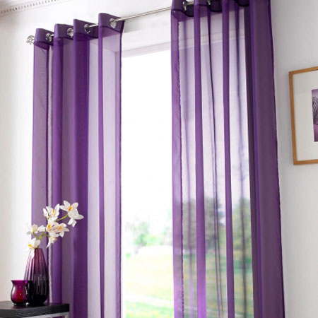 Purple Eyelet Voiles Hung At A Large Window