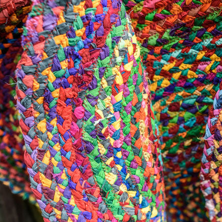 Multi coloured woven rug in lots of bright rainbow colours