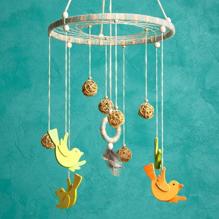 String and wood kids cot mobile with wooden birds in yellow and orange