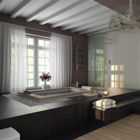 Luxury bathtub on a raised black platform, with white voiles at the window for privacy