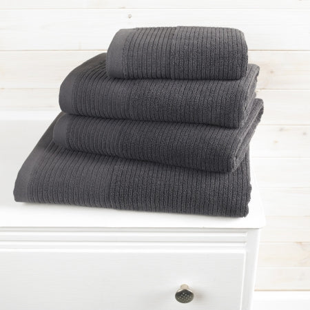 Black towels on a white set of drawers