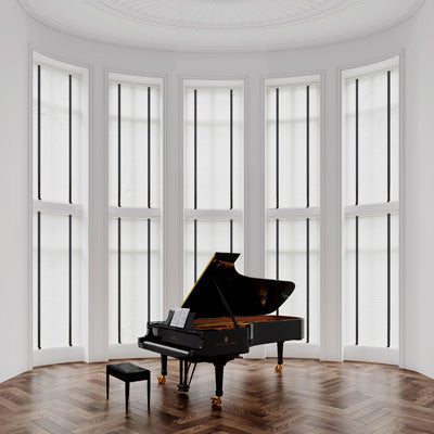 Curved bay window with white blinds in each window, and black grand piano on a dark wooden floor