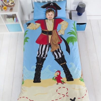 Single kids bedding of a pirate costume standing on the sandy shore