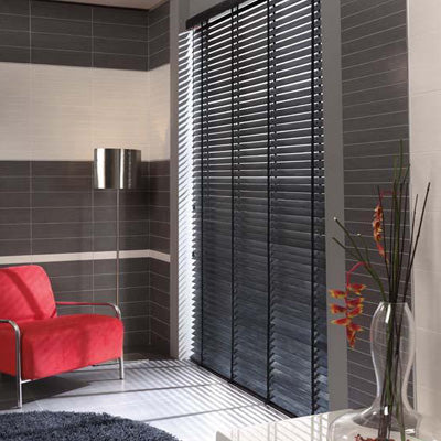 Black venetian blinds in a grey and cream tiled living room
