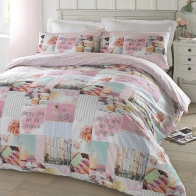 Blush pink, duck egg blue and white double bedding containing pictures of houses macaroons and finger nails