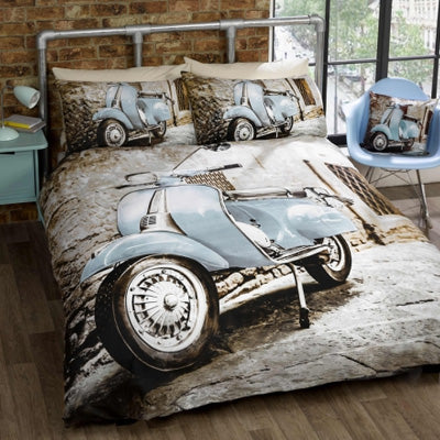 Double bedding with a printed photo of a light blue motor scooter in front of a brick wall
