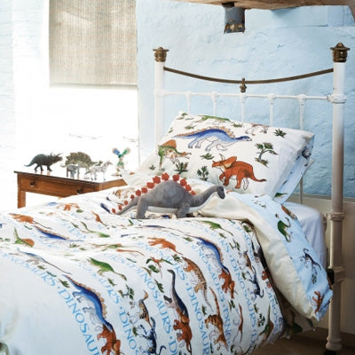 White and light blue single bedding with an illustrated dinosaur design