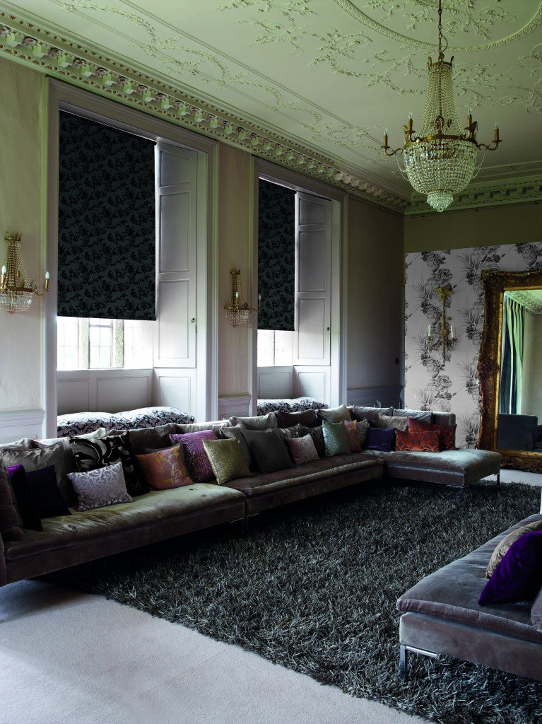 Traditional and vintage living space with high ceiling and velvet furniture