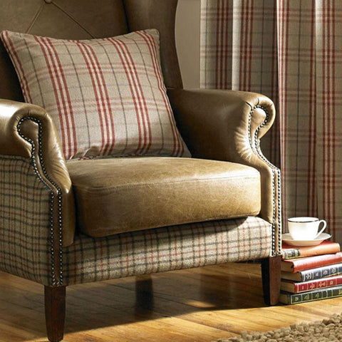 Beige and red checked cushion on a leather armchair