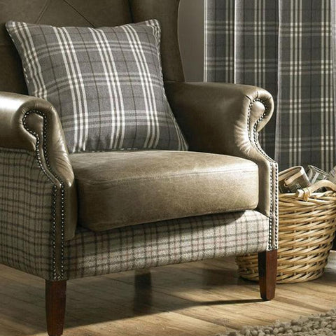 Grey and white checked cushion on a leather armchair