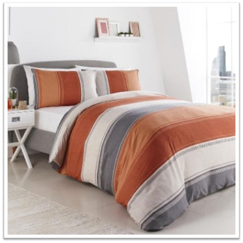 White, grey and orange bedding on a double bed