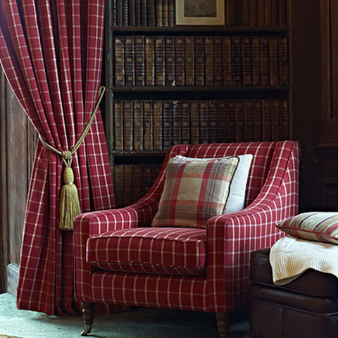 Red and white checked curtains and matching armchair