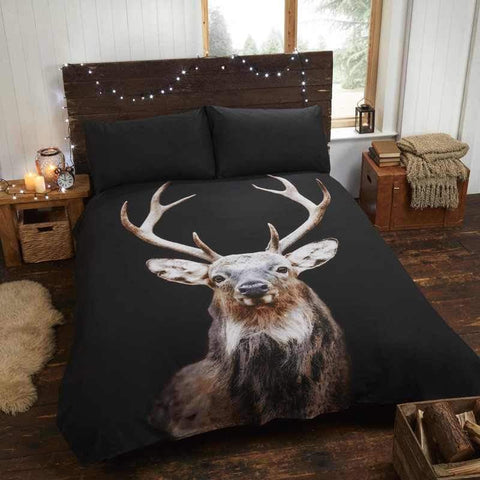 Black bedding with large stag deer printed image on it