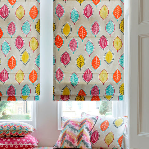 Beige roman blinds with a colourful leaf pattern
