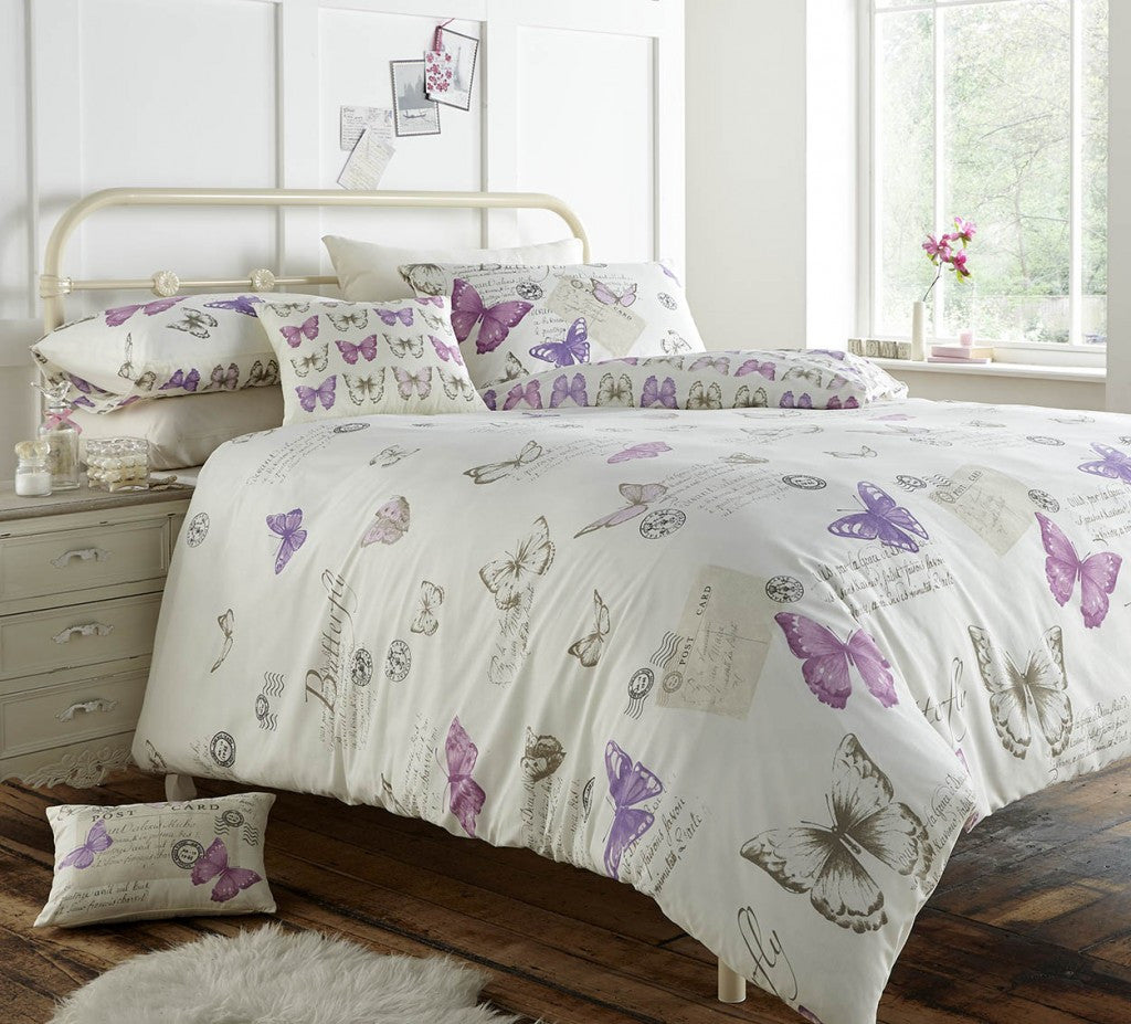 Cream bedding with purple butterflies, plus mail and postmark