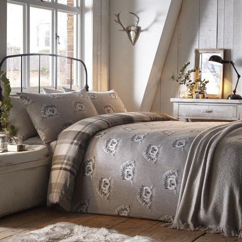 Grey bedding with hedgehog repeat pattern