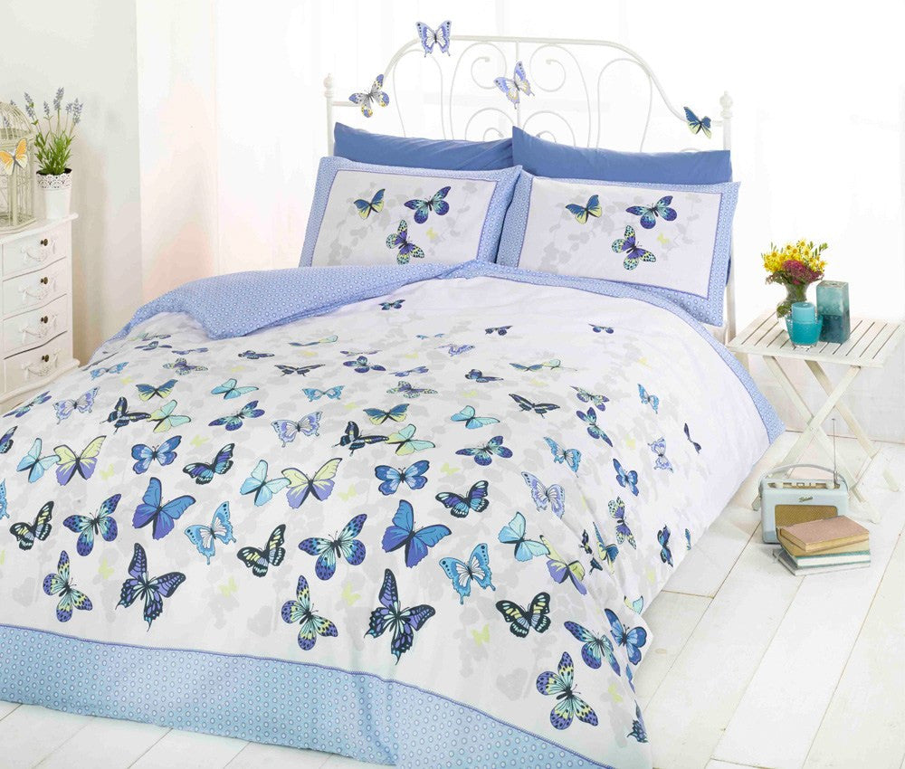 White bedding with blue butterflies, on a white metal bed frame