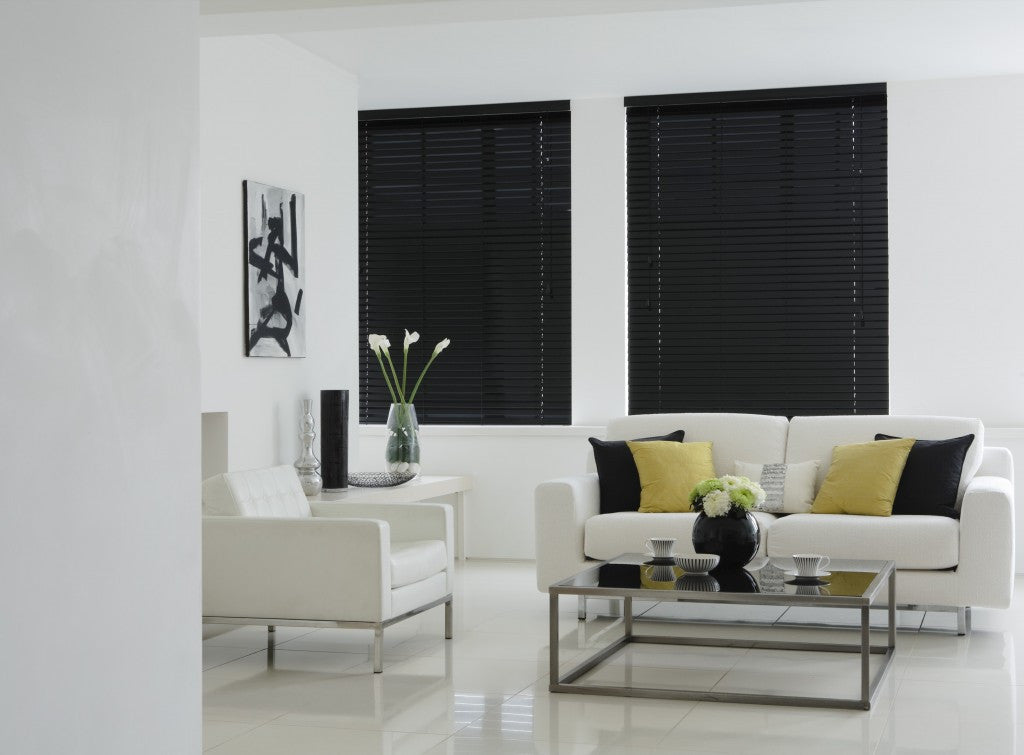 Gloss Black venetian blinds in a white living room