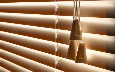 Light creeping through wood effect venetian blinds
