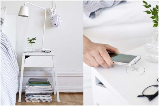 Ikea wireless phone charger on a bedside table