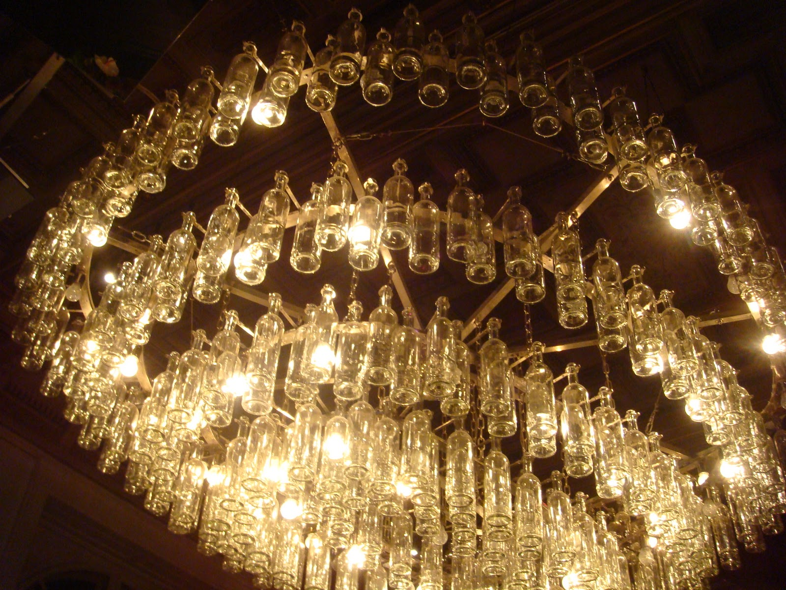 Large glass chandelier made from recycled glass bottles