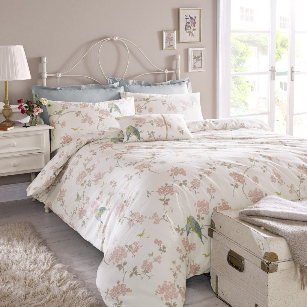 Cream bedding with pink blush floral design and blue and yellow birds