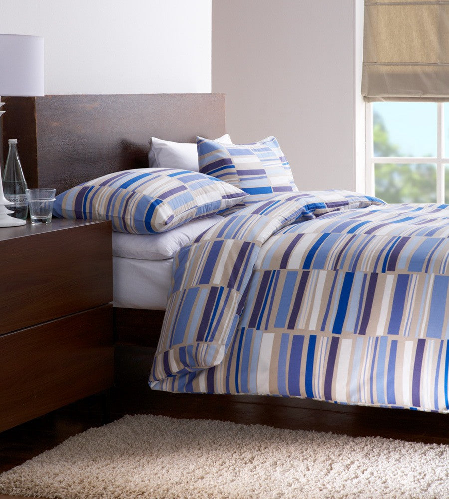 Beige bedding with different coloured rectangles covering the bedding to create a block work pattern