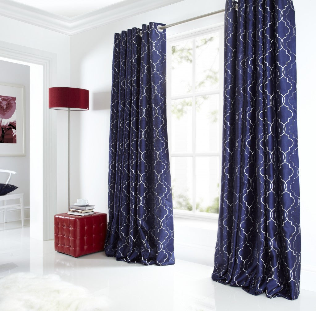 Dark blue curtains with an intricate white geometric design