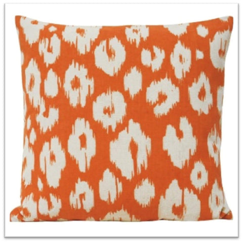 Orange and white square cushion