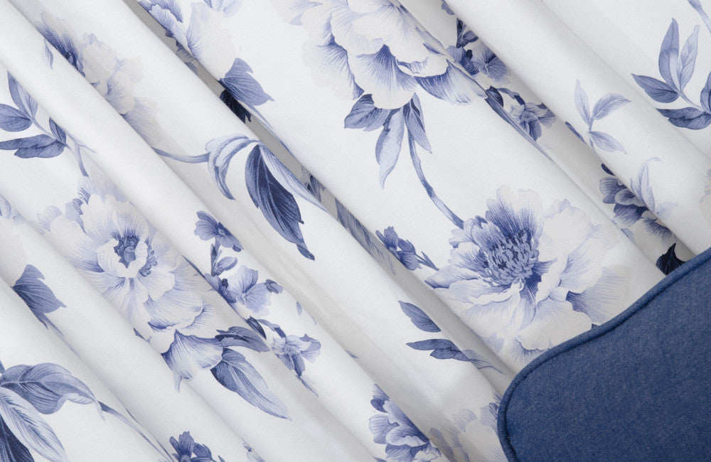 White and blue floral fabric rumpled and gathered