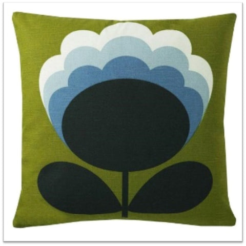 Green cushion with black and blue flower design