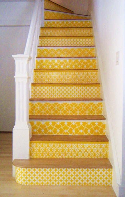 Yellow and white painted staircase, with intricate patterns in white