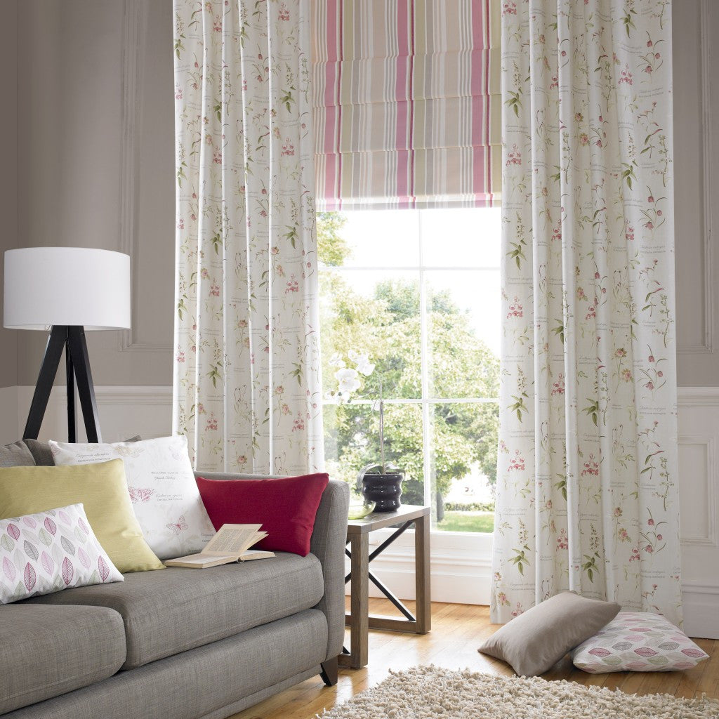 Cream curtains with intricate green and pink floral pattern