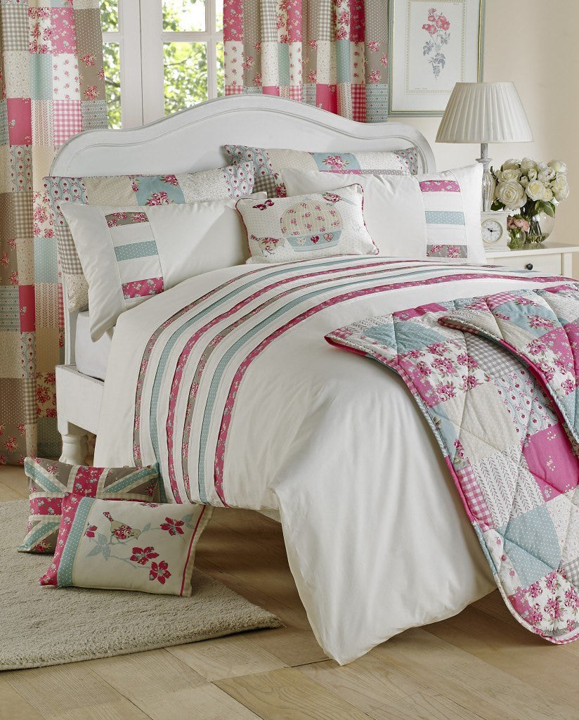 Cute cream, pink and duck egg fabrics used on bedding, cushions and curtains