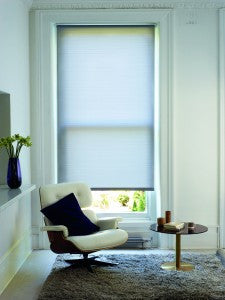 Light roller blind in a white room
