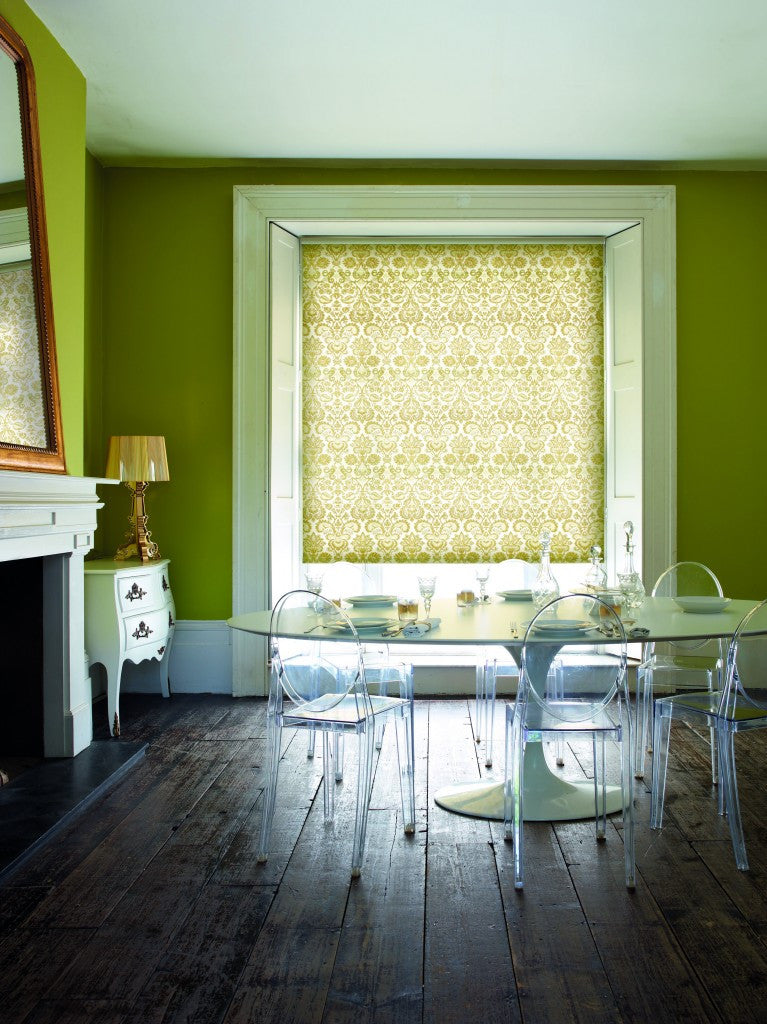 Green dining room with little light, and light green damask roller blind