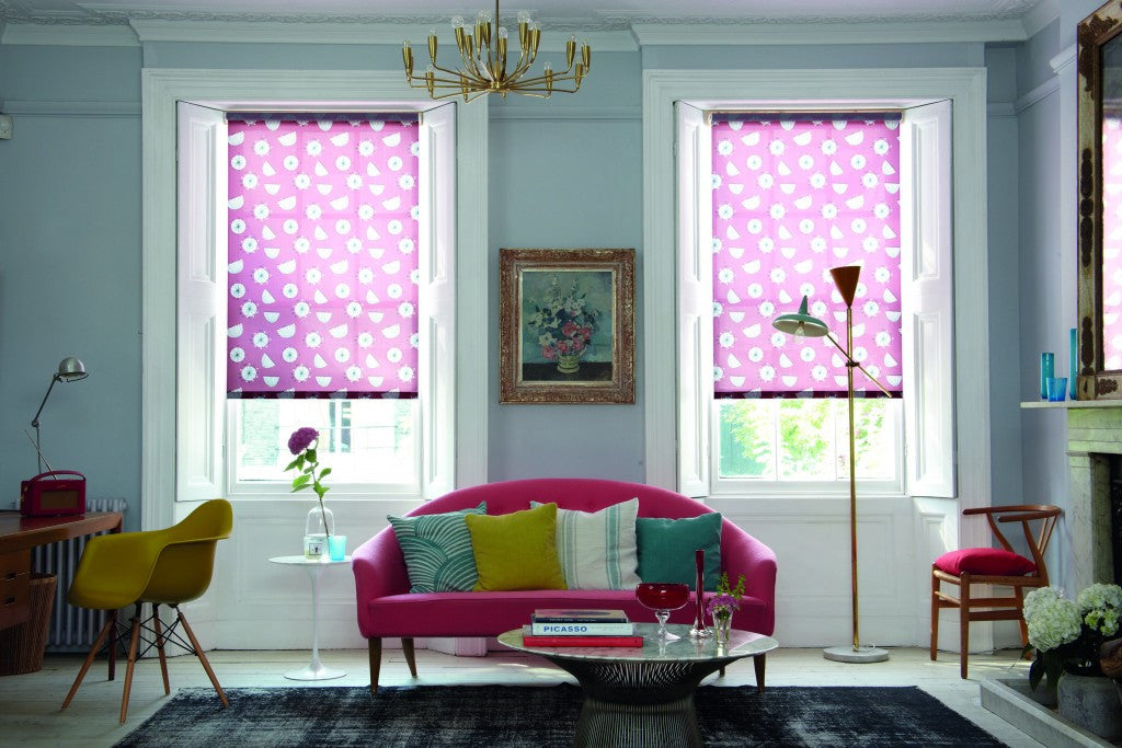 Pink roller blinds in a modern living room