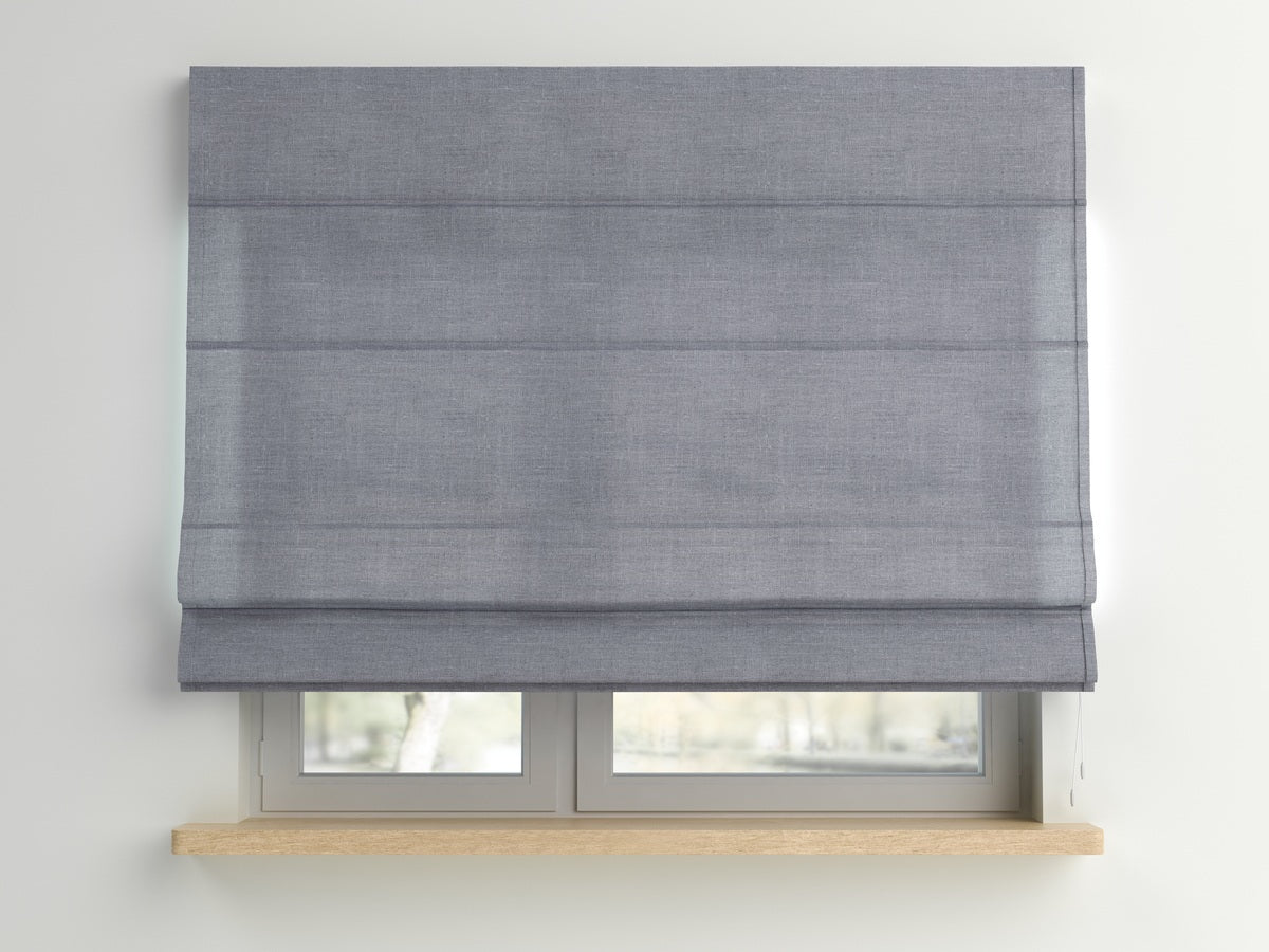 Grey roman blinds at a window