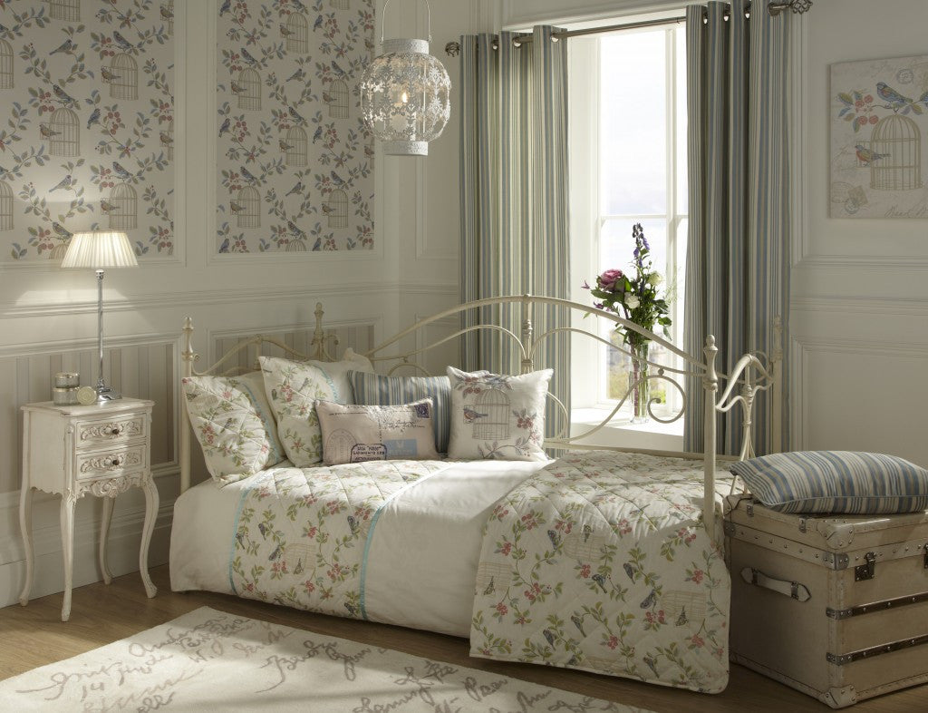 Cream bedroom with bird and birdhouse design used on walls and bedding