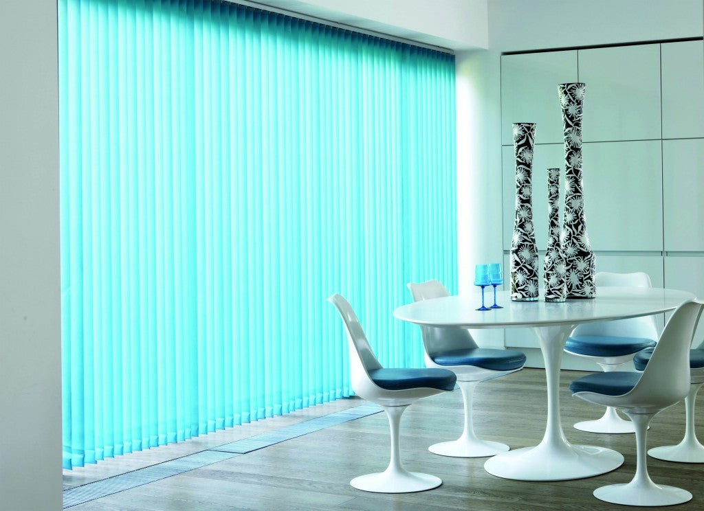 Light blue vertical blinds in a dining room